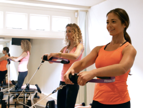 Doing Pilates with a friend is a highly effective way to get fit