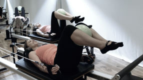 Working lats and inner thighs at the Peacock Pilates Reformer Studio in Central London